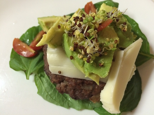 Home-made grass-fed burger, greens/basil, avocado, sprouts and cheese